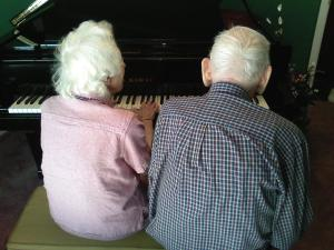 My mother and father sitting at my piano/2008